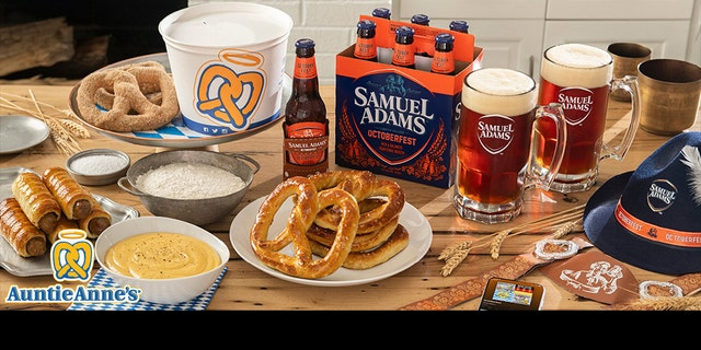The Oktoberfest At Home Kit includes a six-pack of Samuel Adams beer, a DIY pretzel kit from Auntie Anne's, party hats and lederhosen suspenders. (PRNewsfoto/Auntie Anne's)
