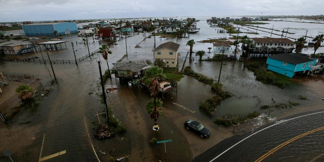 Some roads remain flooded in Surfside Beach, Texas, after Tropical Storm Beta made landfall overnight, on Tuesday, Sept. 22, 2020.