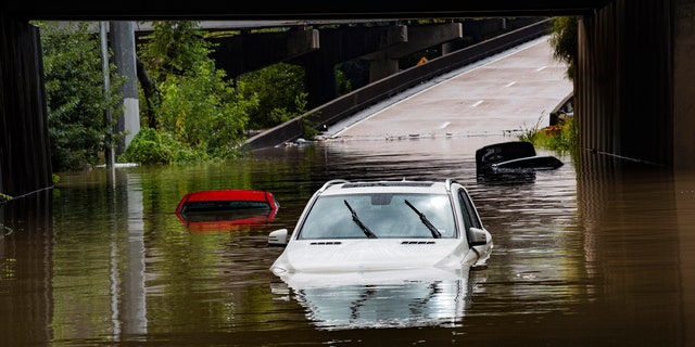 Cars stranded on high flood waters on Houston Ave. exit from Interstate 45 during Tropical Storm Beta Tuesday, Sept. 22, 2020, in Houston.