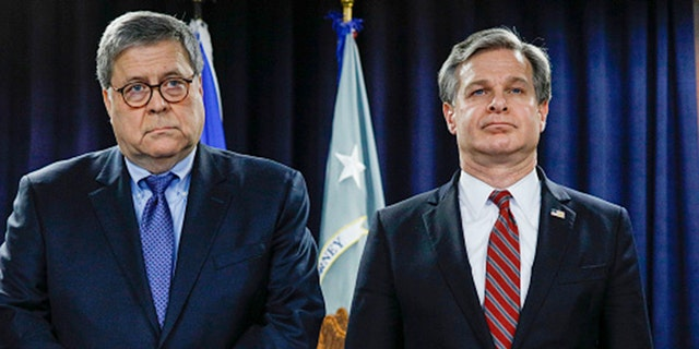 US News U.S. Attorney General William Barr (left) and FBI Director Christopher Wray stand together at an announcement of a Crime Reduction Initiative designed to reduce crime in Detroit on Dec. 18, 2019, in Detroit, Mich. (Bill Pugliano/Getty Images)