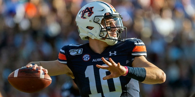 In this Saturday, Nov. 30, 3019, file photo, Auburn quarterback Bo Nix throws against Alabama during the first half of an NCAA college football game, in Auburn, Ala. (AP Photo/Vasha Hunt, File)