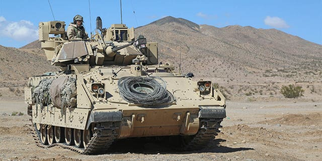 U.S. Army Soldiers from Bravo Company, 1st Battalion, 8th Cavalry Regiment, 2nd Brigade Combat Team, 1st Cavalry Division, provide security around a local town during Decisive Action Rotation 15-05 at the National Training Center in Fort Irwin, Calif., March 3, 2015. Decisive Action Rotations are geared toward an adaptive enemy in a complex environment. (U.S. Army photo by Sgt. Charles Probst/Released)
