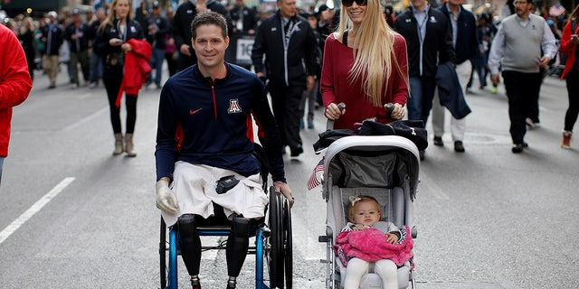 United States Air Force Senior Airman Brian Kolfage, a triple amputee who lost both his legs and an arm while serving his second deployment in Iraq in 2004, attends the Veterans Day parade with his wife Ashley in New York City in 2014. (Reuters)