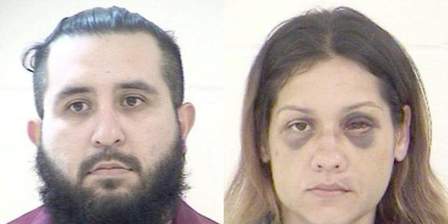 Mugshots for Armando Barron, 30, and Britany Barron, 31.