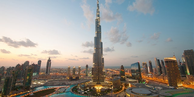 Dubai's Burj Khalifa rises high above the city and is known as the tallest building in the world.