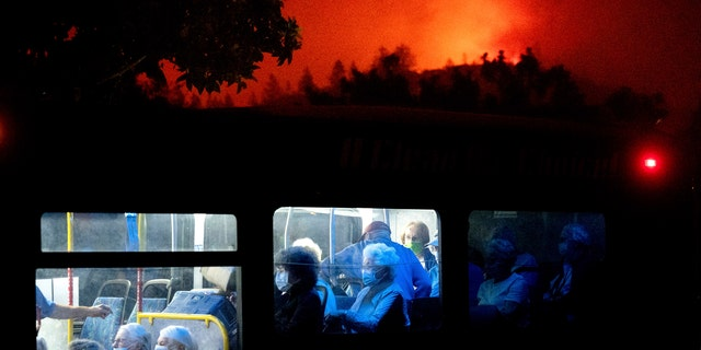 Residents of the Oakmont Gardens senior home evacuate on a bus as the Shady Fire approaches in Santa Rosa, Calif., Monday, Sept. 28, 2020.