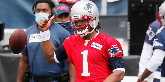 New England Patriots quarterback Cam Newton (1) warms up before an NFL football training camp scrimmage, Friday, Aug. 28, 2020, in Foxborough, Mass. (AP Photo/Michael Dwyer, Pool)