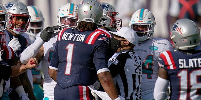 New England Patriots quarterback Cam Newton has words with Miami Dolphins players after an NFL football game, Sunday, Sept. 13, 2020, in Foxborough, Mass. (AP Photo/Charles Krupa)