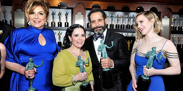 Caroline Aaron, Alex Borstein, Rachel Brosnahan, and Tony Shalhoub, winners of Outstanding Performance by an Ensemble in a Comedy Series for 'The Marvelous Mrs. Maisel', pose in the trophy room during the 26th Annual Screen Actors Guild Awards at The Shrine Auditorium on January 19, 2020, in Los Angeles, California.