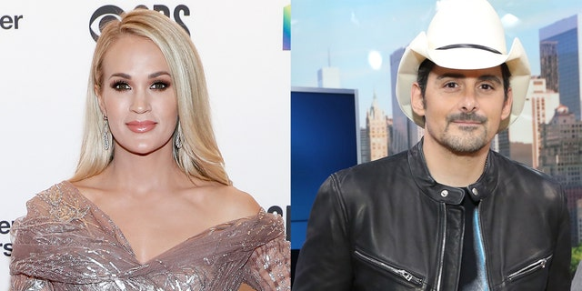 Country stars Carrie Underwood (left) and Brad Paisley performed together -- socially distanced -- at the Grand Ole Opry.