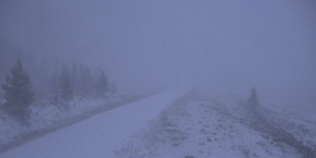Snow was falling Tuesday morning in northern Colorado as a storm system moved into the area.