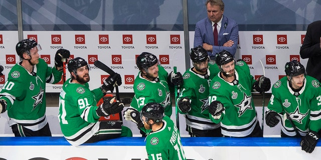 Dallas Stars center Joe Pavelski (16) celebrates his goal against the Tampa Bay Lightning with teammates on the bench during the first period of Game 4 of the NHL hockey Stanley Cup Final, Friday, Sept. 25, 2020, in Edmonton, Alberta. (Jason Franson/The Canadian Press via AP)
