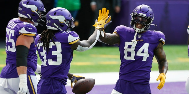 Minnesota Vikings running back Dalvin Cook celebrates with teammate Irv Smith (84) after scoring on a 1-yard touchdown run during the first half of an NFL football game against the Green Bay Packers, Sunday, Sept. 13, 2020, in Minneapolis. (AP Photo/Bruce Kluckhohn)