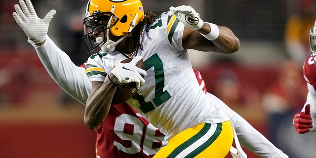 Green Bay Packers wide receiver Davante Adams (17) runs in front of San Francisco 49ers defensive tackle Sheldon Day during the second half of the NFL NFC Championship football game in Santa Clara, Calif. (AP Photo/Tony Avelar, File)