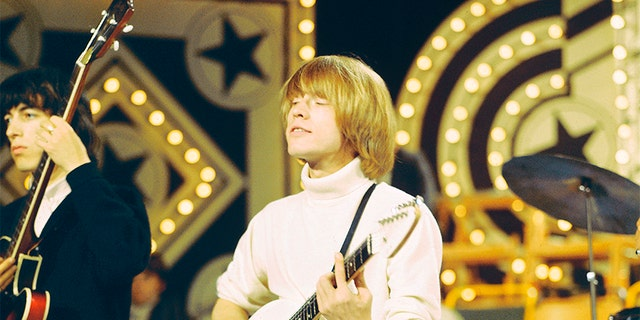 English musician and guitarist Brian Jones (1942-1969) of the rock group Rolling Stones plays a Vox Mark VI Teardrop guitar on the set of the ABC Television pop music television show 'Thank Your Lucky Stars' at Alpha Television Studios in Birmingham, England on 6th June 1965.