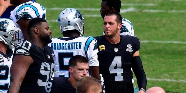 Las Vegas Raiders quarterback Derek Carr and Carolina Panthers quarterback Teddy Bridgewater meet on the field after an NFL football game Sunday, Sept. 13, 2020, in Charlotte, N.C. (AP Photo/Mike McCarn)
