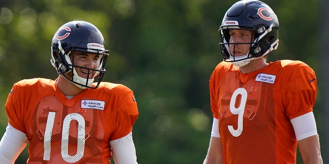 Chicago Bears quarterbacks Mitchell Trubisky, left, and Nick Foles walk on the field during an NFL football camp practice in Lake Forest, Ill. (AP Photo/Nam Y. Huh, File)