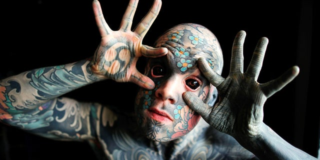 "France's ""most tattooed man""poses with his eyes full of black ink at Palaiseau, southern Paris, France on Sep. 25, 2020. (Reuters/Charles Platiau)"