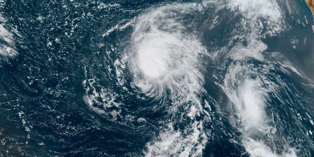 Tropical Storms Paulette (left) and Rene (right) are seen over the Atlantic on Sept. 9, 2020.