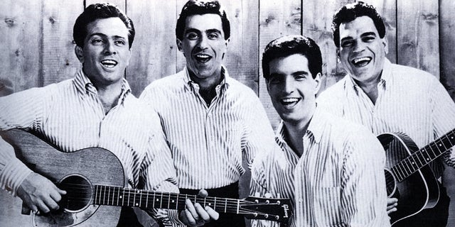 The Four Seasons pose for a group portrait in 1964. From left: Tommy DeVito, Frankie Valli, Bob Gaudio and Nick Massi. (Photo by GAB Archive/Redferns via Getty Images)