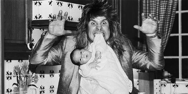 Ozzy Osbourne, former lead singer of Black Sabbath, pictured at home two weeks after the birth of his baby boy Jack on November 25, 1985.