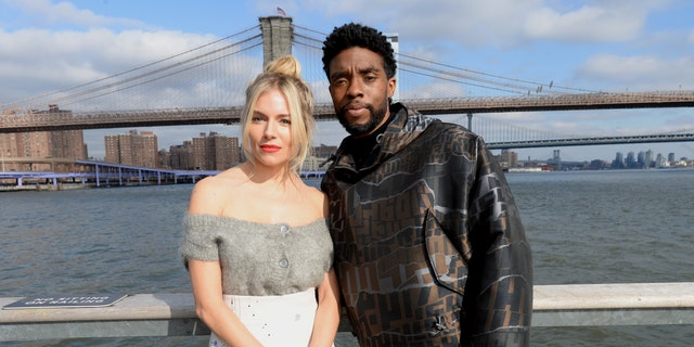 Sienna Miller (L) and Chadwick Boseman (R) starred together in the action thriller 2019 film '21 Bridges.'