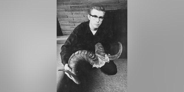 Convicted serial killer Robert Hansen with the horns from a record Dall sheep he killed.