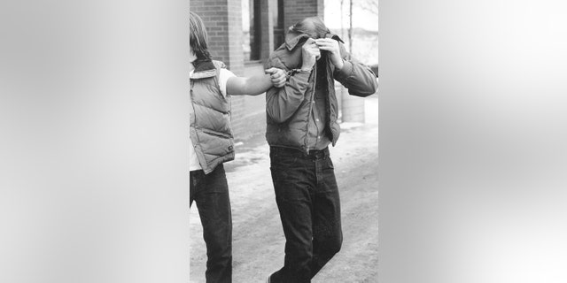 Robert Hansen leaves court during a hearing on multiple murder charges in November 1983.
