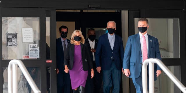 Democratic presidential candidate Joe Biden walks out of the state building with his wife Jill, after voting in the Delaware state primary in Wilmington, Delaware on September 14.