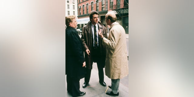 "LAW & ORDER -- ""The Blue Wall"" Episode 22 -- Air Date 06/09/1991 -- Pictured: (l-r) John Christopher Jones as Dennis Shearer, Chris Noth as Detective Mike Logan and Gerry Bamman as Internal Affairs Lt. Kennedy"