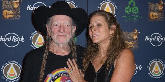 Willie Nelson and Annie D'Angelo attend Hard Rock International's Wille Nelson Artist Spotlight Benefit Concert