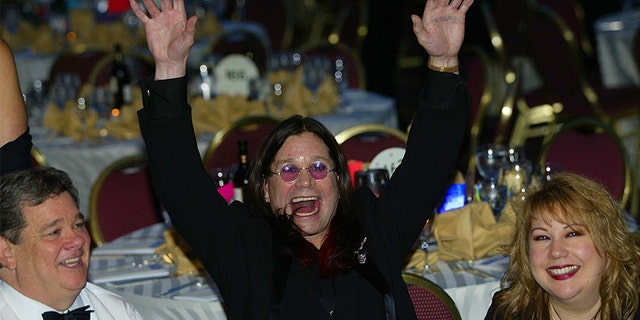 Black Sabbath lead singer and MTV star British Ozzy Osbourne (C) parties at the 2002 annual White House Correspondents Dinner on May 4, 2002, in Washington, DC. US actor/comedian Drew Carey is the featured entertainment for the dinner with attracts leading political figures and Hollywood stars.