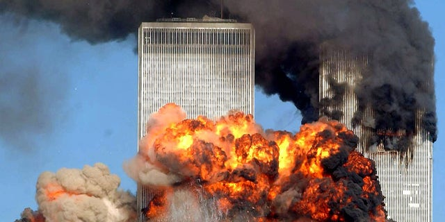 Hijacked United Airlines Flight 175 from Boston crashes into the south tower of the World Trade Center and explodes at 9:03 a.m. on September 11, 2001 in New York City. (Photo by Spencer Platt/Getty Images)