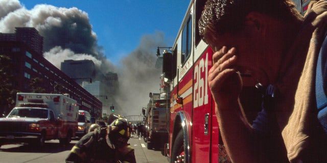 Colour photograph of a New York Fire-fighter amid the rubble of the World Trade Centre following the 9/11 attacks. Dated 2001. (Universal History Archive/Universal Images Group via Getty Images)