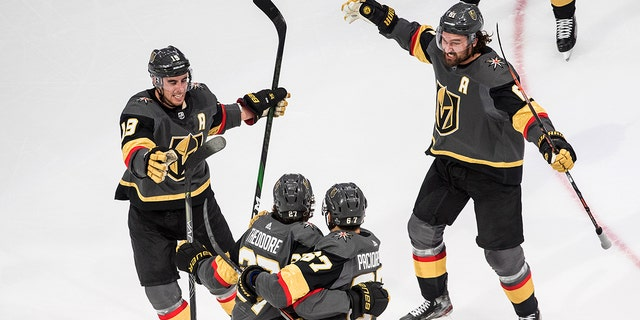 Vegas Golden Knights' Shea Theodore (27) celebrates his goal against the Vancouver Canucks with teammates Reilly Smith (19), Jonathan Marchessault (81) and Max Pacioretty (67) during the third period of Game 7 of an NHL hockey second-round playoff series, Friday, Sept. 4, 2020, in Edmonton, Alberta. (AP)