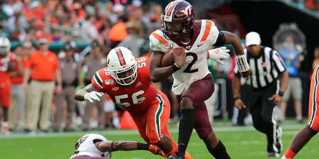 In this Saturday, Oct. 5, 2019, file photo, Virginia Tech quarterback Hendon Hooker (2) runs as Miami linebacker Michael Pinckney (56) defends during the first half of an NCAA college football game in Miami Gardens, Fla. Virginia Tech plays North Carolina State on Saturday, Sept. 26. (AP Photo/Lynne Sladky)
