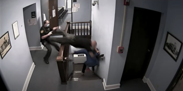 Highland County Sheriff's Deputy Ben Reno is captured on surveillance video leaping over a stair railing.