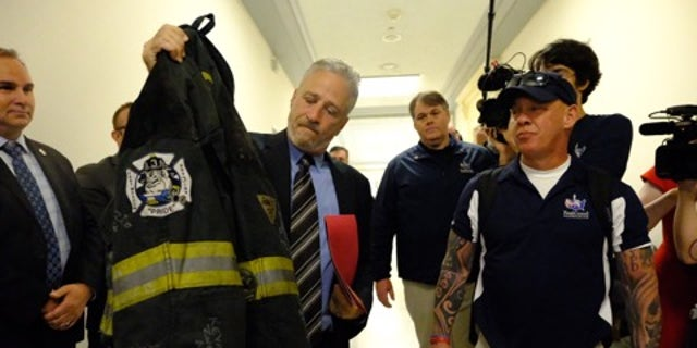 Jon Stewart and Jon Feal (right), who successfully fought for compensation due to 9/11 first responders, are now focusing their efforts to lobby for a new bill that will provide the same sort of relief for U.S. Veterans who claim they were made sick from burn pit exposure.