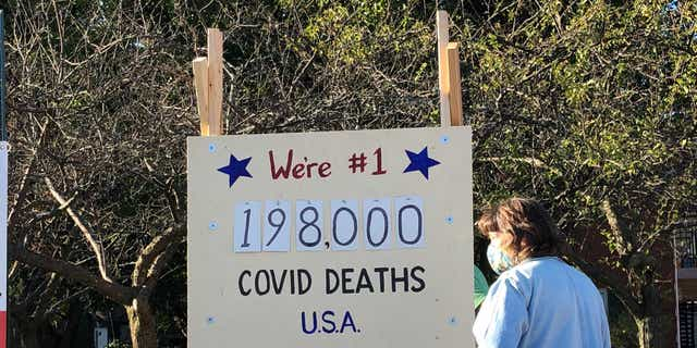 A 'scoreboard' showing the coronavirus death toll was put on display in Northbrook, IL