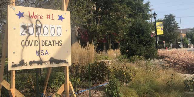 The anti-Trump display in referred to as the 'Coronavirus Death Scoreboard' was vandalized on evening of Sept. 22 in Northbrook, Ill.
