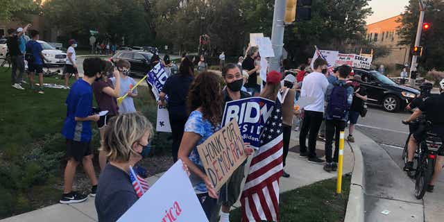 A group of anti-Trump protests gathered across the street from a pro-Trump demonstration on Sept. 25 in Northbrook, Ill.