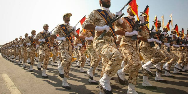 Members of the Iranian revolutionary guard march during a parade to commemorate the anniversary of the Iran-Iraq war.