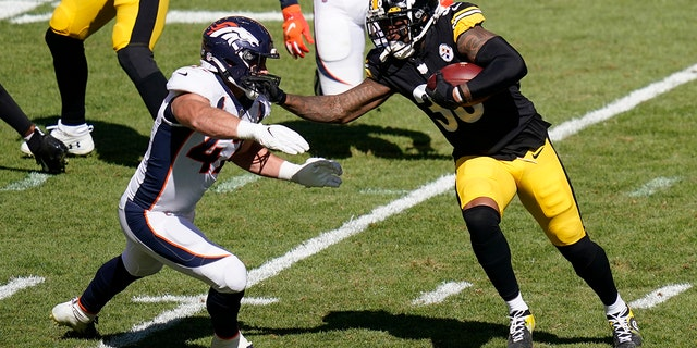Pittsburgh Steelers running back Jaylen Samuels (38) stiff-arms Denver Broncos inside linebacker Josey Jewell (47) during the second half of an NFL football game, Sunday, Sept. 20, 2020, in Pittsburgh. (AP Photo/Keith Srakocic)