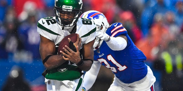 File-New York Jets wide receiver Jamison Crowder (82) catches a pass for a touchdown in front of Buffalo Bills' Dean Marlowe (31) during the second half of an NFL football game Sunday, Dec. 29, 2019, in Orchard Park, N.Y. (AP Photo/Adrian Kraus, File)