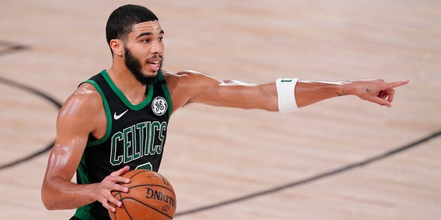 Boston Celtics' Jayson Tatum directs a play during the second half of an NBA Eastern Conference finals game against the Miami Heat Friday, Sept. 25, 2020, in Lake Buena Vista, Fla. (AP Photo/Mark J. Terrill)