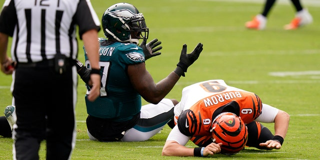 Cincinnati Bengals' Joe Burrow (9) reacts after a hit by Philadelphia Eagles' Malik Jackson (97) during the first half of an NFL football game, Sept. 27, in Philadelphia. (AP Photo/Chris Szagola)