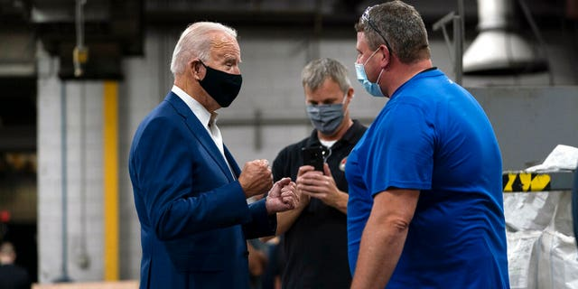 Democratic presidential candidate former Vice President Joe Biden talks with workers as he tours the Wisconsin Aluminum Foundry in Manitowoc, Wis., Monday, Sept. 21, 2020. (AP Photo/Carolyn Kaster)