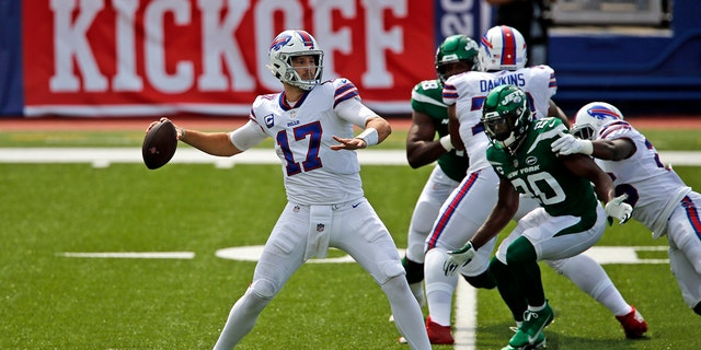 Buffalo Bills quarterback Josh Allen (17) throws a pass during the first half of an NFL football game against the New York Jets in Orchard Park, N.Y., Sunday, Sept. 13, 2020. (AP Photo/John Munson)