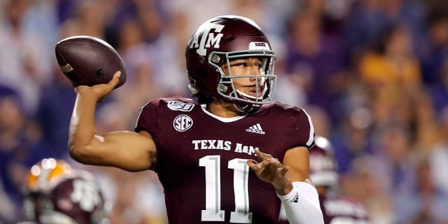 In this Nov. 30, 2019, file photo, Texas A&M quarterback Kellen Mond throws a pass during the first half of the team's NCAA college football game against LSU in Baton Rouge, La. Mond will lead No. 10 Texas A&M in the opener against Vanderbilt on Saturday, Sept. 26, 2020. (AP Photo/Gerald Herbert, File)