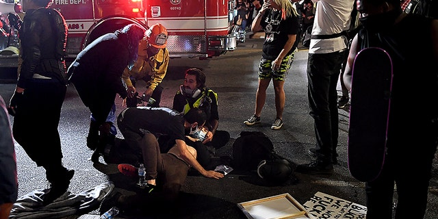A protester who was hit by a car receives assistance from paramedics in Hollywood, Calif., Sept. 24, 2020. (Getty Images)